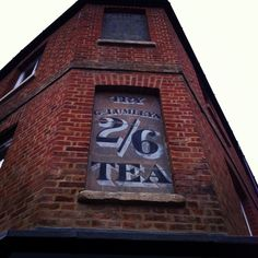 'Try Geo. Lumley's 2/6 Tea' advertising 'ghost sign' ... faded advertising sign painted on wall of building (in bricked up corner window), c. early-mid 20th century, Jericho, Oxford, UK