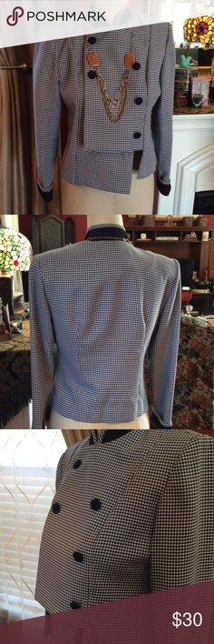 Navy Gingham Double Breasted Jacket Trimmed in solid navy covered buttons, cuffs, and collar.  Would look great with solid navy pants or skirt!  Very tailored with padded shoulders and stitched pleats. 50% Polyester and Rayon. There is a button hole without a button at the very top.  I purchased it new that way and never saw it as a flaw. JSJ Jackets & Coats Blazers