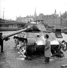 Still standing where it fought till the end, a Porsche version King Tiger 2 remains in place as a reminder of the conflicts violent past in this photo taken in late 1945.