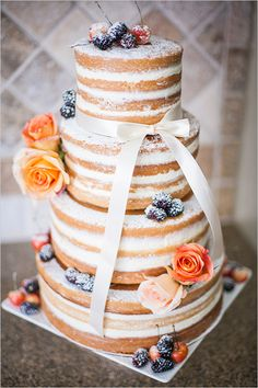 Rustic elegance achieved with this beautiful naked cake by Dolce Designs.