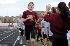 Remington Elementary School fifth grader Braeden Holcombe, 11, wins a boys 800-meter dash event May 16 at Sand Creek High School in Falcon School District 49. More than 300 fourth and fifth graders from the district's nine elementary schools gathered for the annual track competition. During the daylong athletic activities, they competed in eight events: 100- and 200-meter sprints; 800-meter dash; 4-by-100-meter relay; long jump; shot put; softball throw; and Frisbee toss.