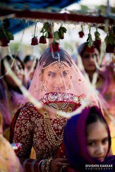 Bridal Details - Bride in a Marsala Blouse and a Net Pink Dupatta as Veil | WedMeGood | Photo by: Divishth Kakkar Photography #wedmegood #indianbride #indianwedding #bridal #veil #netveil #marsala #bridaldetails #net