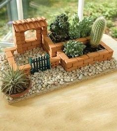 Tiny garden arranged with tiny brick walls. #fairygarden #fairygardenminiatures