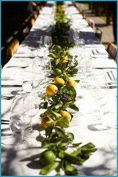 I REALLY like this idea of a running garland down the table.  I could use sprigs of pine/fir with pine cones and LED lanterns.