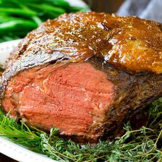 A smoked prime rib roast cooked to medium rare on a serving platter. How To Cook Ribs, How To Cook Steak, Pellet Grill Recipes, Beef Recipes, Smoker Recipes, Rib Roast Cooking, Cooking Steak, Cooking Ribs, Prime Rib Sauce