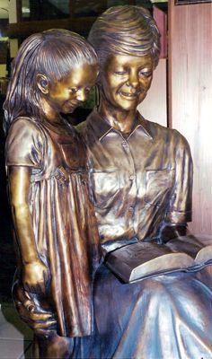 Custom lifesize bronze sculpture scenes, teacher reading to children bronze, Wilson Public Library, Cozad Nebraska, public monumental portra...