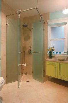Shower Solution #3: Replacing an under-used soaking tub with a fold-away shower made this bath comfortable and accessible.
