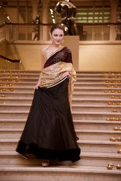 BLACK/PURPLE LEHENGA SAREE Embroidery: MIRROR AND STONE WORK. Fabric: VELVET, LACE, AND NET
