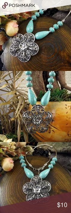 Turquoise flower necklace New in packaging.  Silver.  Made of alloy metal.   Chain length measures: 19 inches.   NO TRADES, OFFERS OR MODELING!!! Jewelry Necklaces