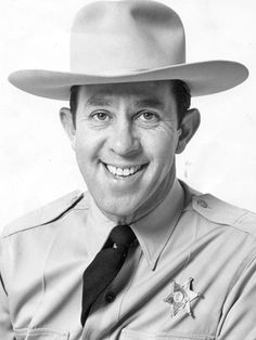 """John Rovick donned a sheriff's hat, khaki uniform and badge to become Sheriff John on KTTV's daily """"Cartoon Time"""" show."""