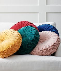 "Layer up with something different: the circular shape of our Elyse Velvet Pillow adds something extra to seating or your bed, especially in rich, velvet colors with pleated patterning. At 20"" in diameter, it's a design solution where just a touch of texture, color, and shape can brighten up a bigger space."
