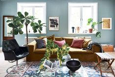 Mustard yellow sofa and blue walls in a bohemian Stockholm apartment - - Warm colors, natural materials and vintage finds in a spacious Stockholm apartment Sage Living Room, Living Room Colors, Stockholm Apartment, Yellow Sofa, Interior And Exterior, Interior Design, Georgia Homes, Sofa Pillows, Blue Walls