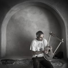 I found this local musician busking in an old castle entrance. Perfect light and beautiful music!