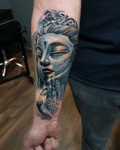 Blue Buddha Tattoo on the Arm.