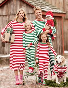 Christmas pj photo, this is adorable but I don't believe I would ever get my grown husband to wear a set of pjs like that, nor out in public to take a family photo! Lol AT