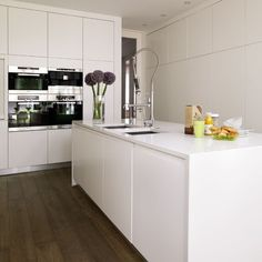 Beautiful Banked ovens Be inspired by a white minimalist kitchen housetohome co uk