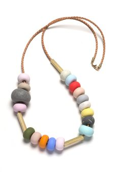 This necklace is part of the Memphis Terrazzo range and features eighteen hand-formed textured and coloured polymer clay beads paired with rectangu...