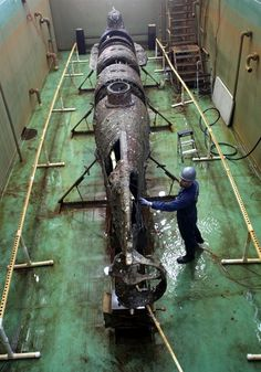 The H.L. Hunley Civil War submarine unveiled for first time, 12 January 2012, Charleston, SC.