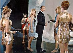 David Niven as Sir James Bond and Barbara Bouchet as Miss Moneypenny in the 1967 spoof Casino Royale