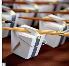 Carrie's cousin folded 175 origami cranes and packaged them in take-out boxes with chopsticks. According to Japanese tradition, the crane is a symbol of luck and loyalty in marriage.