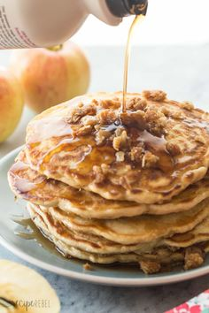 These Apple Crisp Pancakes are soft, fluffy cinnamon pancakes filled with shredded apple and topped with brown sugar crumble -- a decadent weekend breakfast!