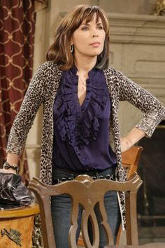 Feminine ruffled shirt with animal print jersey jacket, hip belt and jeans..