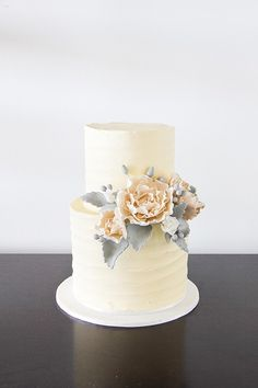 Muted palette of cream and grey for a winter wedding cake by The Dainty Baker (via Polka Dot Bride).