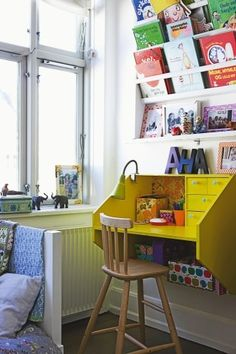 I really love this little mounted desk with the book organizer above it. Would work well for the girls when homework time comes in their future. (most adorable little desk space from a home in Denmark)