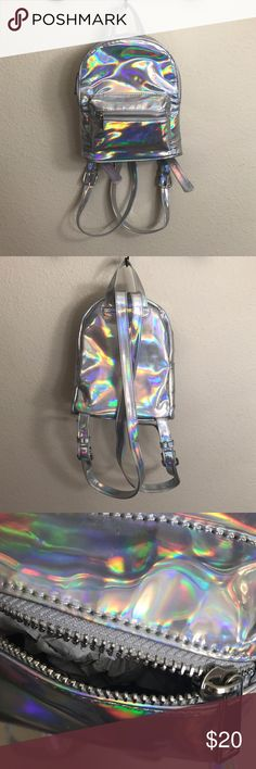 Holographic purse from Forever 21 Holographic mini backpack from Forever 21 ☁️ Superrrr cute and handy to have during any festival this summer ☁️ #dollskill #edc Forever 21 Bags Backpacks