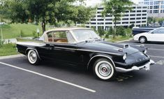 """The Packard Hawk had a fiberglass """"mouth"""", a faux Continental-type spare tire on the trunk lid and leather upholstery. Description from skoshi8.deviantart.com. I searched for this on bing.com/images"""