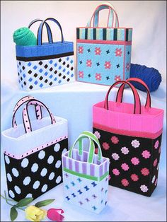 Trendy Totes Plastic Canvas Pattern Download from e-PatternsCentral.com -- Tote your craft projects in style! Included are five fun and fashionable totes featuring polka dots, stripes, floral patterns and butterflies.