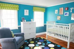 Vibrant nursery. I luv the blues and green and that rug!