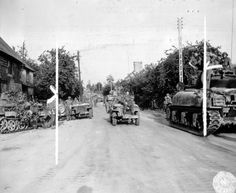 Shermans of the 33rd Tank Regiment/3rd Armored Division and Jeeps of the 117th Infantry Regiment/30th Infantry DIvision in La Chapelle, June...