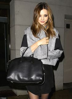 Immaculate: Miranda Kerr didn't let New York's 40-degree temperatures keep her from flaunting her famous pins as she dashed out for a meal Saturday night