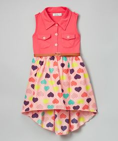 A button-up top and skirt dotted with hearts create a dress that's equal parts trendy and playful.