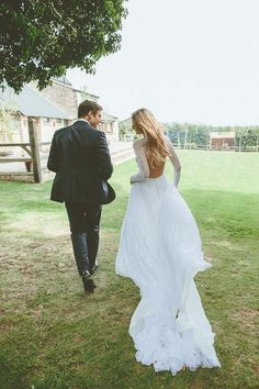 Amazing long sleeve and open back wedding dress, perfect for the stylish fall bride!