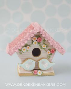 3D cookie bird house decorated with Royal icing