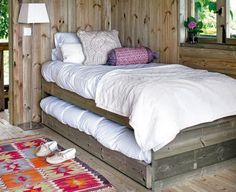 love these rustic trundle beds....super cute for a small space
