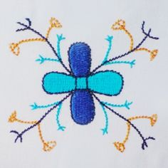 Estonian archaic medieval machine embroidery design.  A cross surrounded by contours has been a protective symbol. A cross combined with a tree of life was used as a symbol of fertility. Combine with other archaic motifs and you will get a unique piece of clothing or accessory as a result. Here both classic and handlook technique have been used.