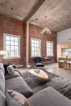 Tall interiors give the modern industrial apartment a visually spacious and cheerful ambiance