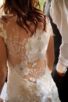 the back of this gown! - photo by Pepper Nix Photography, gown by Claire Pettibone - http://ruffledblog.com/backyard-chic-utah-wedding/