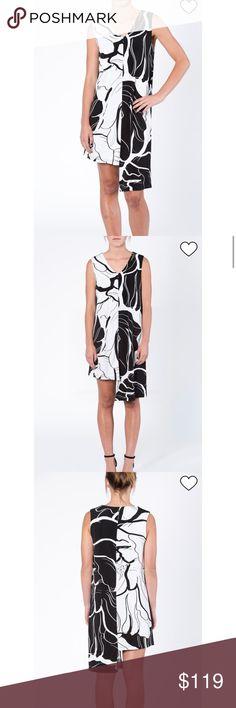 Modern Tunic Dress Black and white modern print tunic dress featuring high-low hemline and v-neckline. Last Tango Dresses Mini