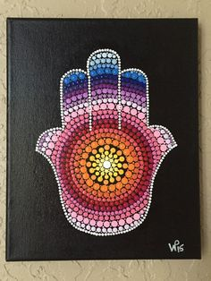 This Hamsa painting is made up of all hand painted tiny dots. The canvas measures 8x10. Ready to hang- the sides are painted black so no need for