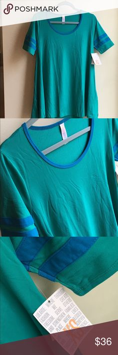 NWT LuLaRoe Deep Jade & Blue Perfect T Shirt XS This NWT Perfect T by LuLaRoe has it all! Amazing, rich jewel tone colors of deep jade green with sporty deep blue stripes on the arms. And, this is leggings material, so it's incredibly soft. Size extra small (xs), but Perfect T's run large, so this would easily fit a size medium. If you haven't tried a Perfect T before, they are so flattering on all body types and pair perfectly with leggings for backside coverage, lol! Made in Vietnam. 95%…