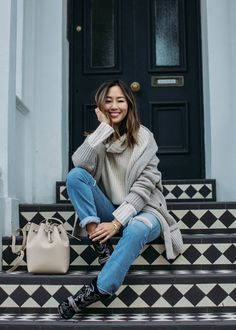 Aimee Song pairs a Zara coat and cardigan with a Glamorous turtleneck sweater for some casual neutral layers in Notting Hill, London