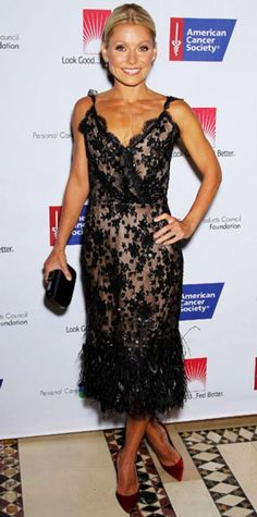 Look of the Day › September 24, 2011 WHAT SHE WORE Ripa arrived at the American Cancer Society Dream Ball in a feathered cocktail dress that she paired with a satin clutch and ruby heels.