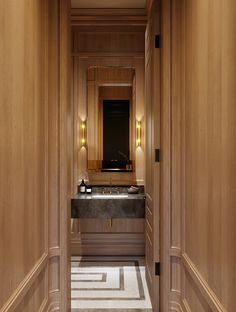 Incredible oak paneled Powder Room by Toronto Design firm McGill Design Group. Curved brass sconces and brass mirror available on www.myplumdesign