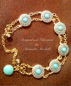 Love this Bracelet by Alexandra Marshall fabricated with turquoise clay and resin cabochons traversing 18kt gold overlay links. Magnetic clasp and safety chain. Custom sized to fit. Warranty. Free USA Shipping. $79. reference #B1299. To order double click on the photo.