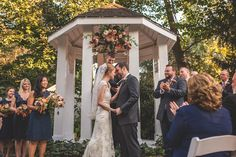 A simple splash of fall color was perfect for this October garden wedding at CJ's Off the Square, just south of Nashville, TN  Joe Hendricks Photography