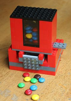 AWESOME! Learn how to construct a Homemade Candy Dispenser with LEGO bricks!